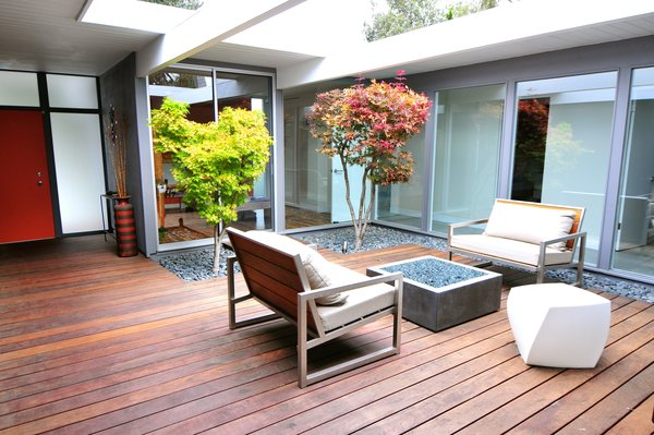 Modern home with living room, stools, light hardwood floor, sofa, and coffee tables. Photo 8 of Renovated Sunnyvale Eichler