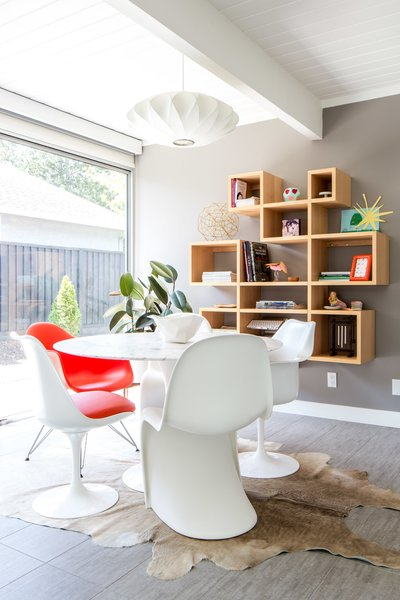 Modern home with dining room, shelves, pendant lighting, table, and chair. Photo 3 of Renovated Sunnyvale Eichler