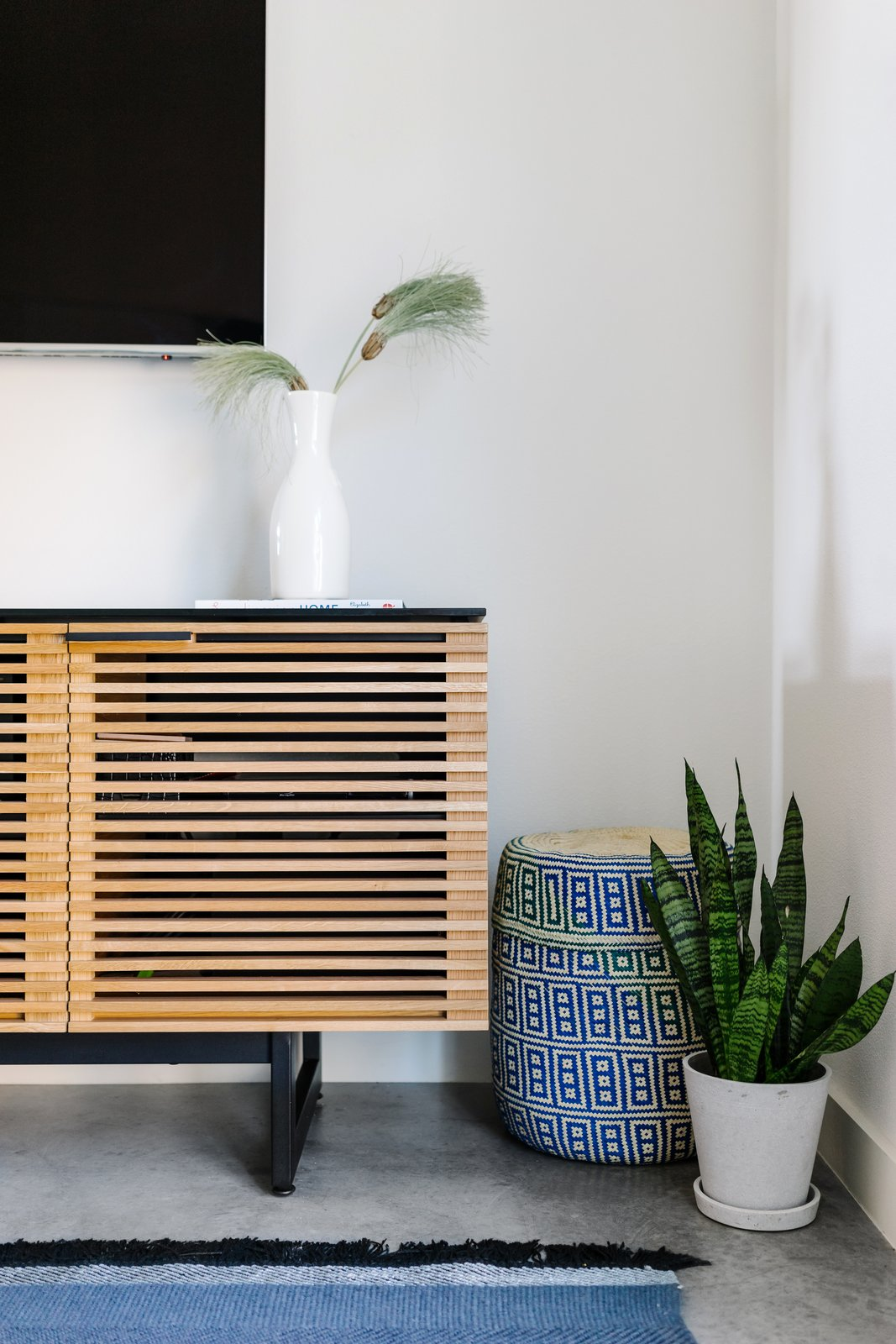 Inspired by their love of ceramics, Turknett blended sculptural ceramics with arid greenery. Tagged: Storage Room and Cabinet Storage Type.  Photo 6 of 7 in St. Barts-Inspired Accents Create Modern Tranquility in an Austin Tilley Row Home