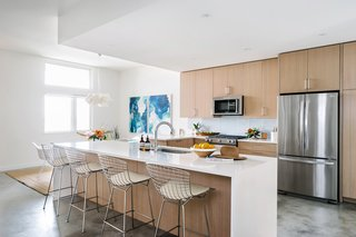 Knoll's Bertoia counter stools were chosen to complement the hardware in the kitchen.