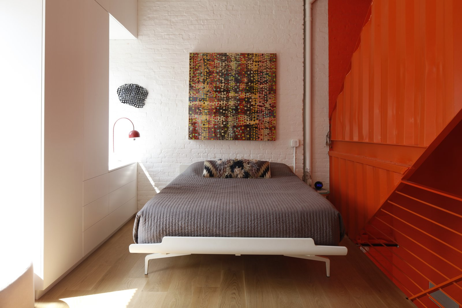 Tagged: Bedroom, Bed, Light Hardwood Floor, and Table Lighting.  Photo 9 of 12 in A Brooklyn Carriage House Is Revamped With a Penthouse Made From Shipping Containers