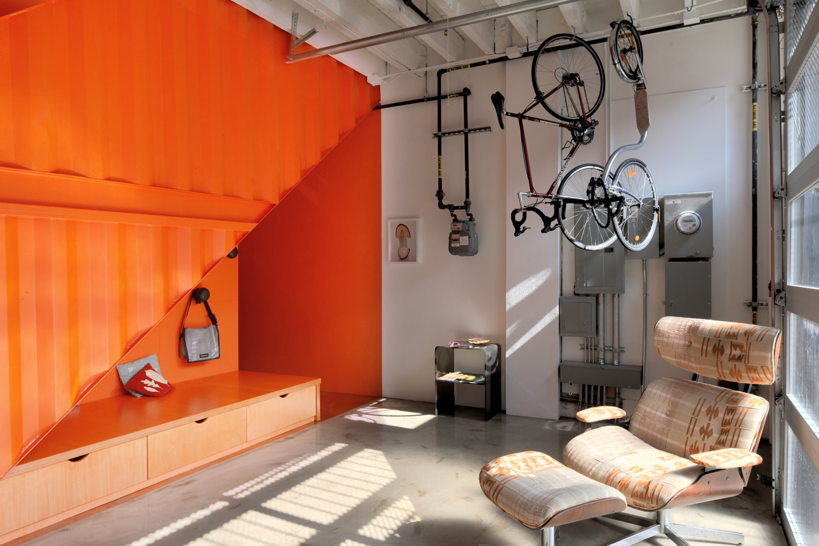 Tagged: Living Room, Bench, Chair, Storage, and Concrete Floor.  Photo 7 of 12 in A Brooklyn Carriage House Is Revamped With a Penthouse Made From Shipping Containers