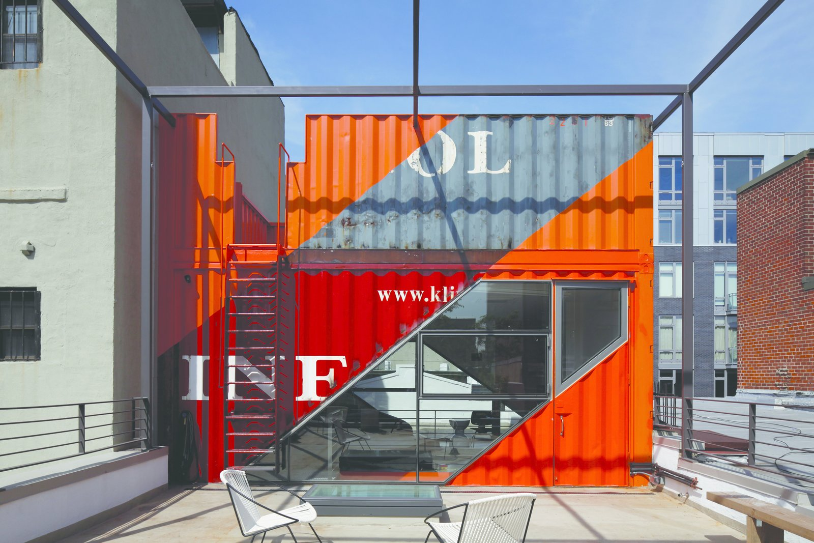Tagged: Outdoor, Small Patio, Porch, Deck, Rooftop, Concrete Patio, Porch, Deck, Horizontal Fences, Wall, and Metal Fences, Wall.  Photo 11 of 12 in A Brooklyn Carriage House Is Revamped With a Penthouse Made From Shipping Containers