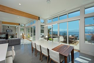 A Pro Hockey Player and His Family's Amazing Lakeside Home - Photo 2 of 2 - Expansive windows allow Shannon and Cory to entertain their family and friends year round—inside and out!