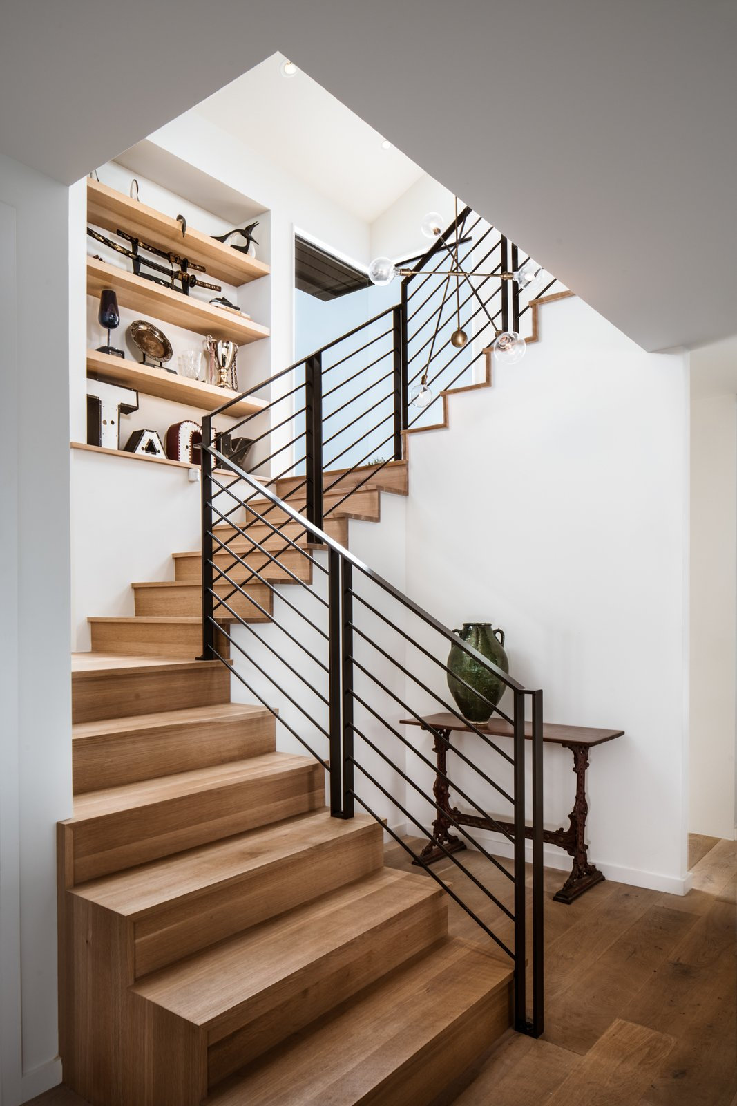 Modern home with Staircase, Metal Railing, and Wood Tread. Stairs Photo 2 of River Garden Trail Residence