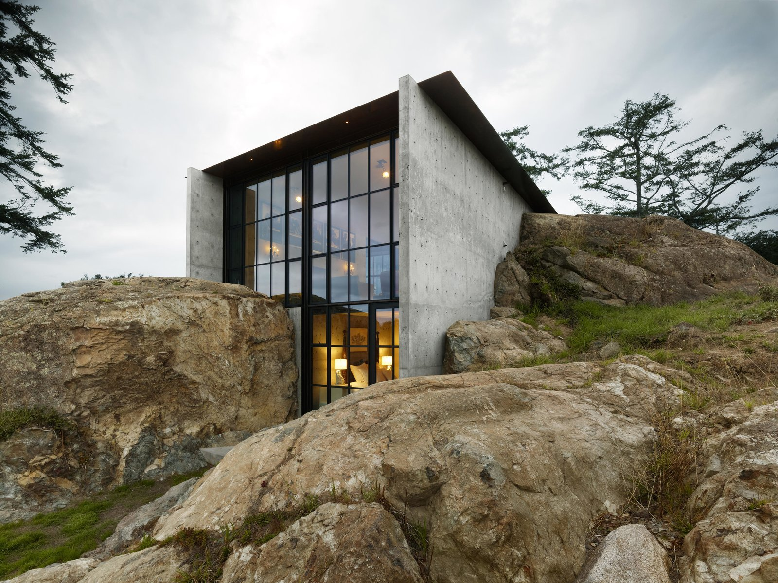 The Pierre | Olson Kundig Tagged: Boulders, Slope, Exterior, House, and Concrete Siding Material.  The Pierre by Olson Kundig