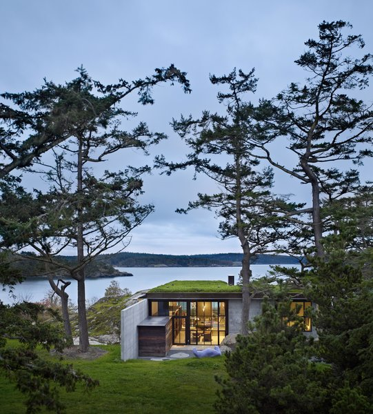 Modern home with outdoor, back yard, grass, and small patio, porch, deck. The Pierre | Olson Kundig Photo 2 of The Pierre