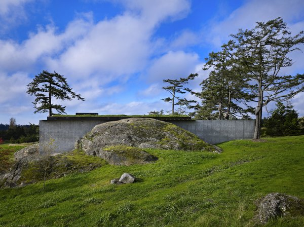 Modern home with outdoor, boulders, and grass. The Pierre | Olson Kundig Photo 3 of The Pierre