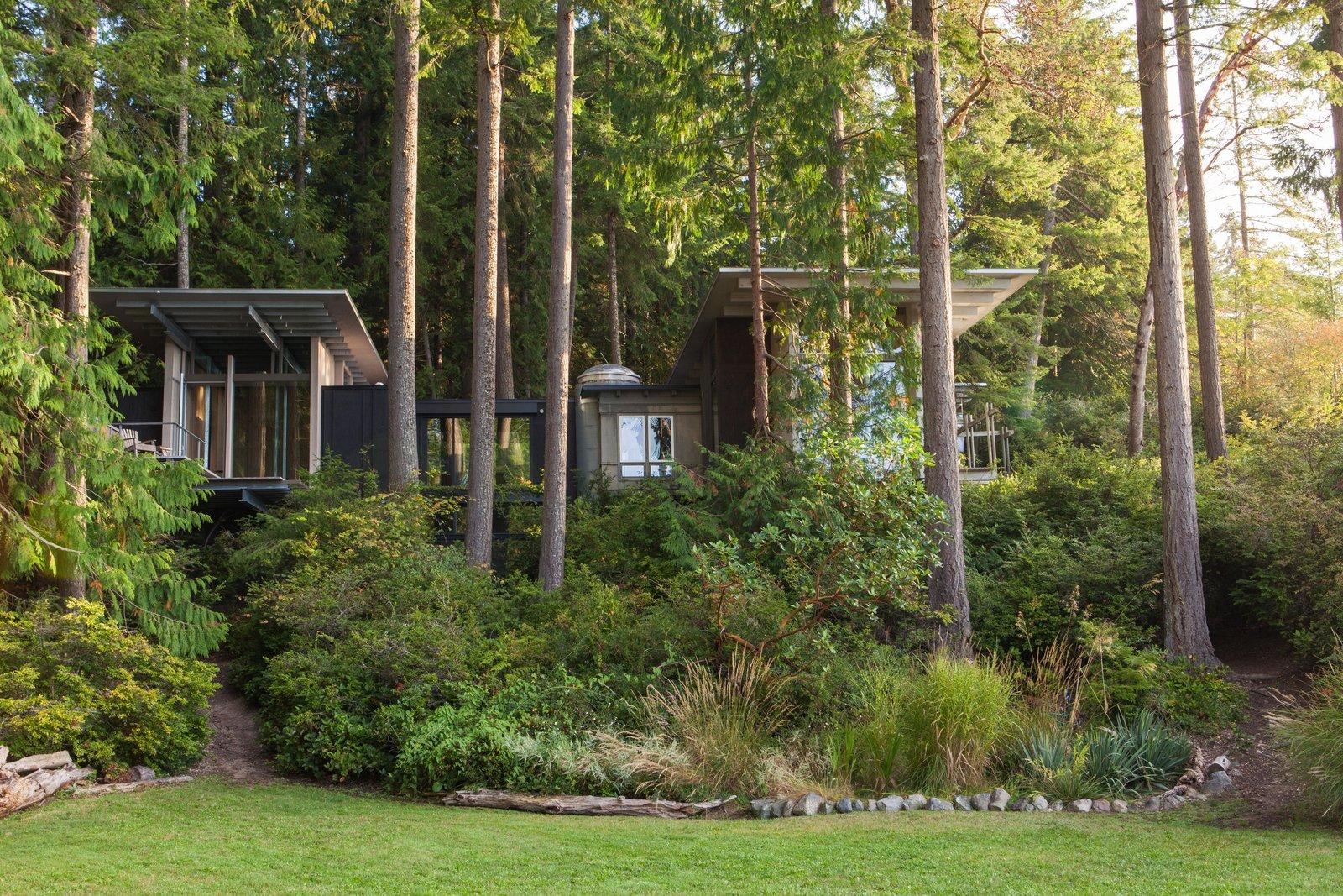 Cabin at Longbranch | Olson Kundig Tagged: Grass, Back Yard, Shrubs, Trees, Exterior, and House.  Cabin in Longbranch by Olson Kundig