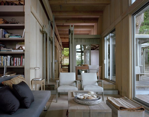 Modern home with living room, chair, and sofa. Cabin at Longbranch | Olson Kundig Photo 5 of Cabin in Longbranch