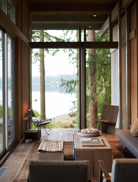 Modern home with living room, coffee tables, chair, and bench. Cabin at Longbranch | Olson Kundig Photo 6 of Cabin in Longbranch