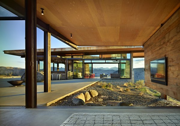 Modern home with outdoor, boulders, large patio, porch, deck, and desert. Studhorse | Olson Kundig Photo 6 of Studhorse
