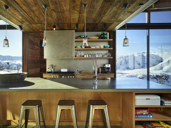 Modern home with kitchen, concrete counter, concrete backsplashe, and pendant lighting. Studhorse | Olson Kundig Photo 12 of Studhorse