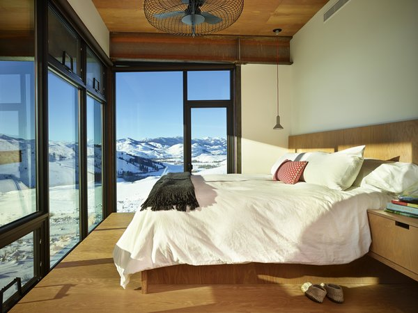 Modern home with bedroom, bed, and pendant lighting. Studhorse | Olson Kundig Photo 13 of Studhorse