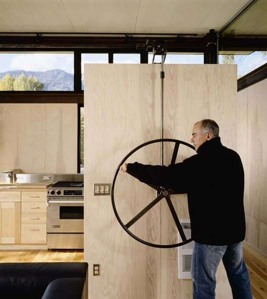 Modern home with kitchen, wood counter, and wall oven. Delta Shelter | Olson Kundig Photo 6 of Delta Shelter