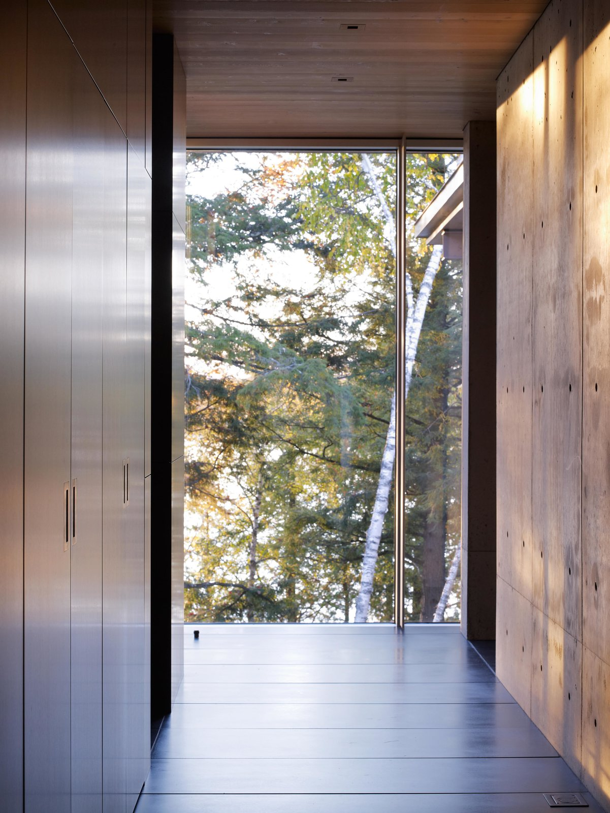 Northwoods House Tagged: Exterior, Wood, Metal, Garden, Coffee Tables, Table, Storage Room, and Chair.  Northwoods House by Olson Kundig