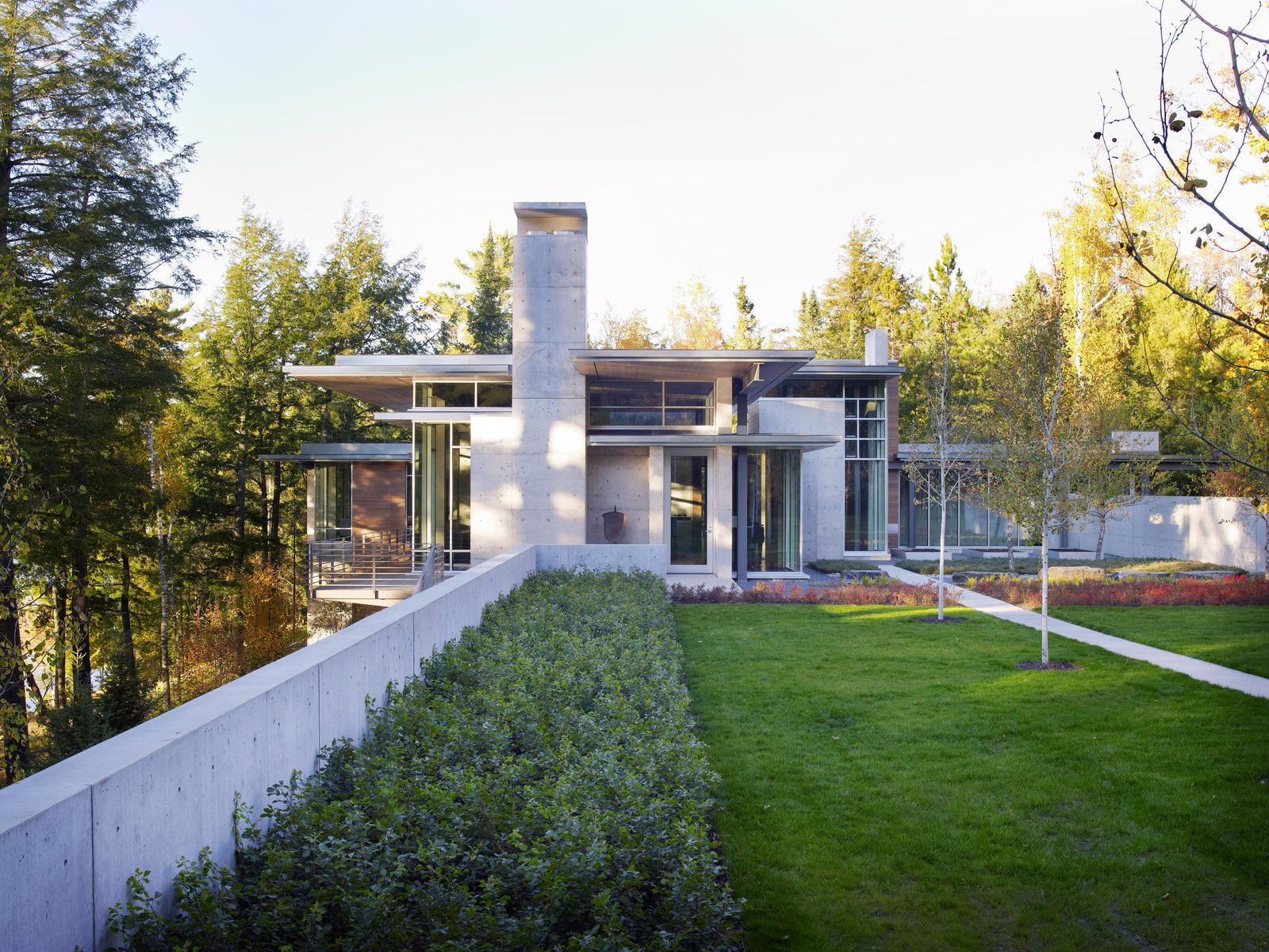 Northwoods House Tagged: Outdoor, Grass, Shrubs, and Back Yard. Northwoods House by Olson Kundig