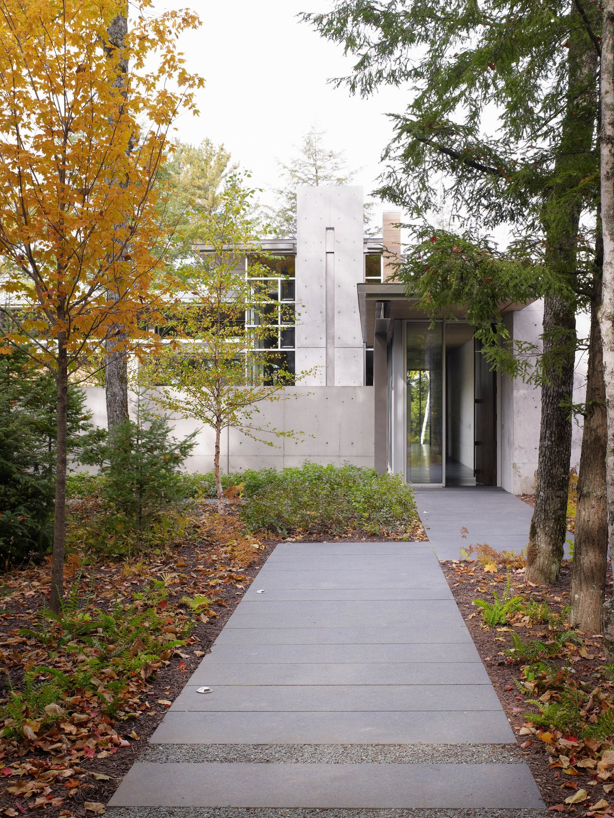 Northwoods House Tagged: Garden, Exterior, Outdoor, and Concrete Patio, Porch, Deck.  Northwoods House by Olson Kundig