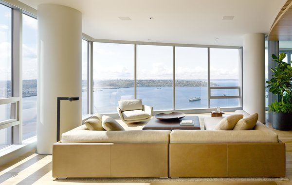 Modern home with living room, sectional, coffee tables, sofa, and end tables. Harbor Loft | Olson Kundig Photo 4 of Harbor Loft
