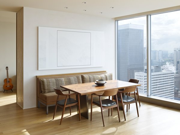 Modern home with dining room, table, and chair. Harbor Loft | Olson Kundig Photo 5 of Harbor Loft