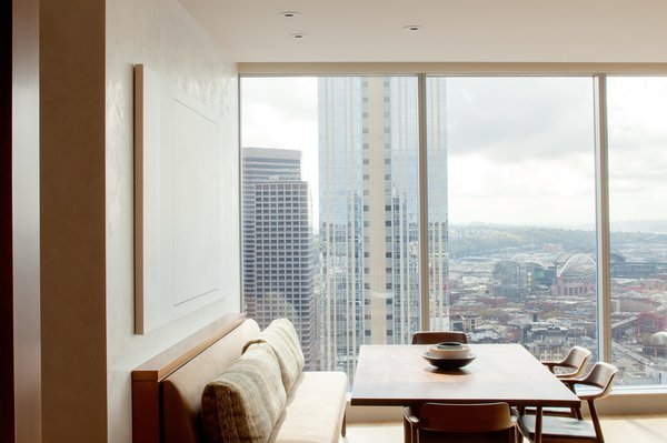 Modern home with dining room, table, and chair. Harbor Loft | Olson Kundig Photo 6 of Harbor Loft