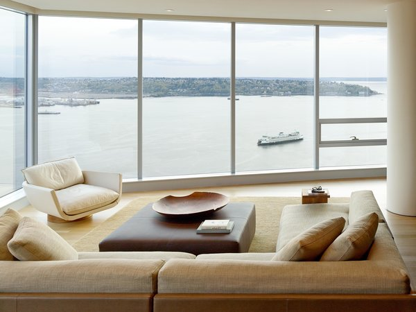 Modern home with living room, sectional, coffee tables, sofa, and end tables. Harbor Loft | Olson Kundig Photo 7 of Harbor Loft