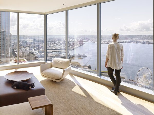 Modern home with living room, ottomans, and chair. Harbor Loft | Olson Kundig Photo 12 of Harbor Loft