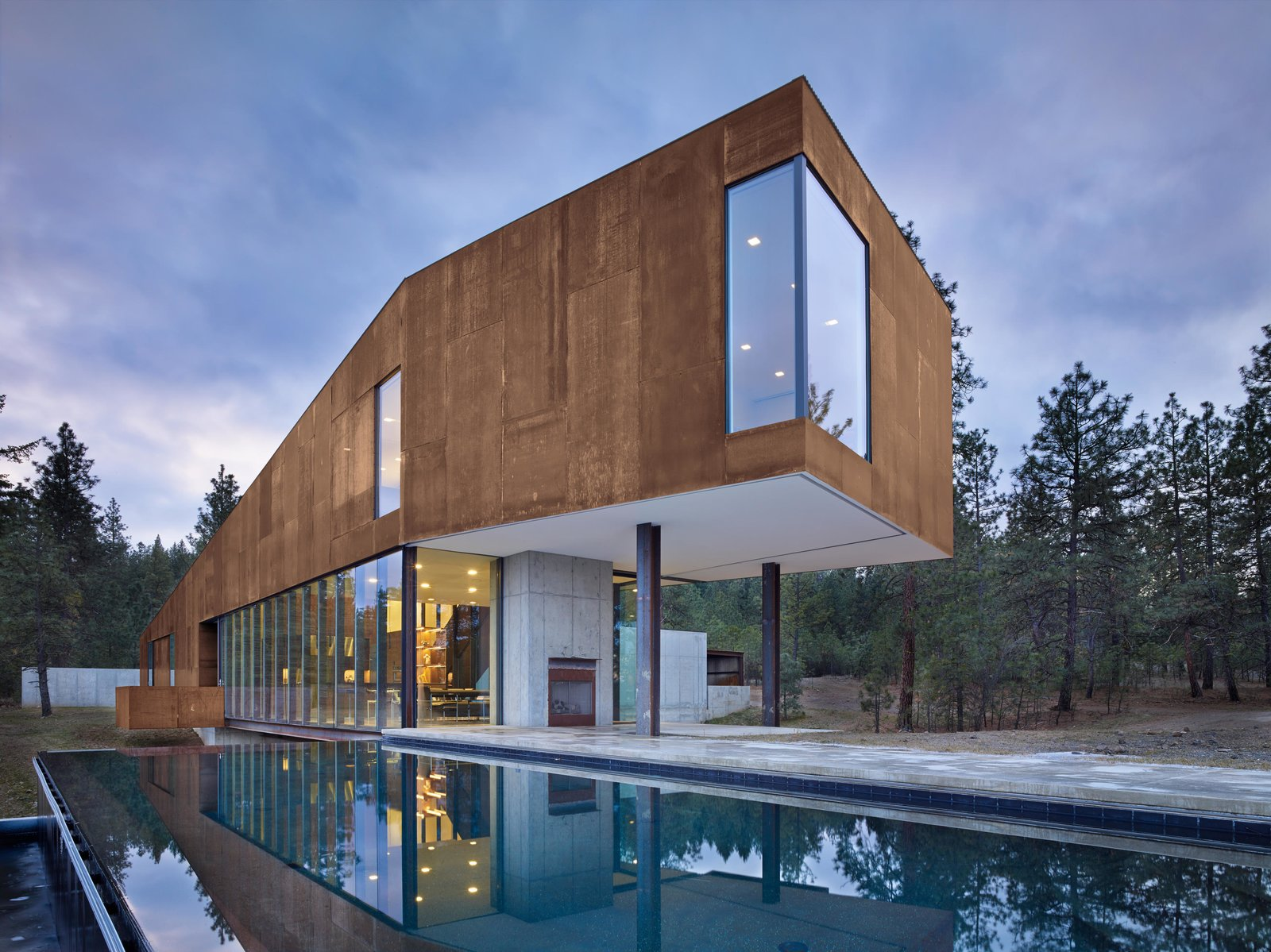 Rimrock | Olson Kundig Tagged: House, Metal Roof Material, Metal Siding Material, Outdoor, Infinity Pools, Tubs, Shower, Concrete Patio, Porch, Deck, Large Patio, Porch, Deck, Back Yard, and Side Yard.  Rimrock by Olson Kundig