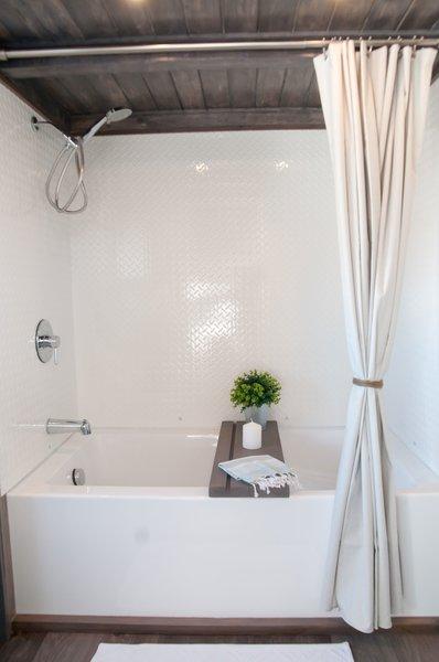 cedar roof & cheker plate bath walls Photo 16 of Tiny house on wheels - The Sakura modern home