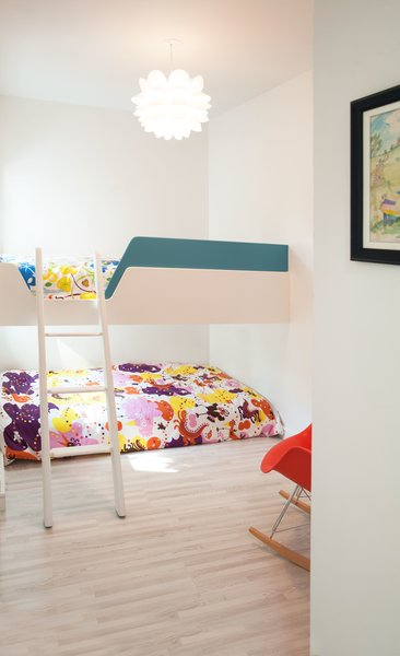 Modern home with bedroom, bed, light hardwood floor, bunks, living room, pendant lighting, ceiling lighting, and accent lighting. Our House - Kids' Bedroom Photo 6 of Our House