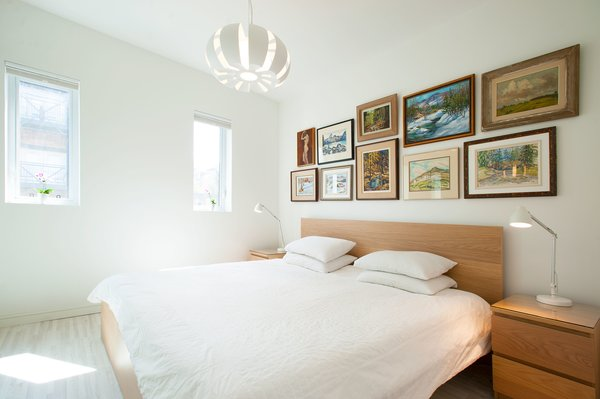 Modern home with bedroom, night stands, bed, table lighting, ceiling lighting, lamps, pendant lighting, accent lighting, and light hardwood floor. Our House - Master Bedroom Photo 7 of Our House