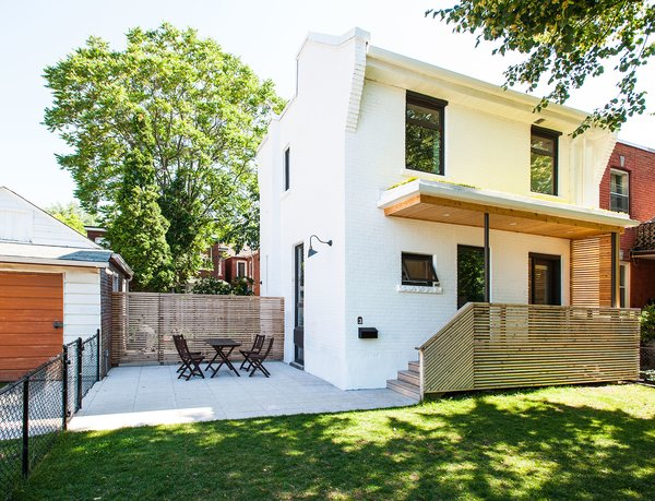 Modern home with outdoor, front yard, grass, wood patio, porch, deck, trees, small patio, porch, deck, wood fence, and horizontal fence. Our House - Exterior Photo 3 of Our House
