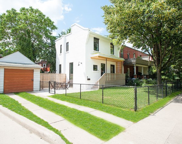 Modern home with outdoor, trees, side yard, grass, front yard, wood patio, porch, deck, horizontal fence, wood fence, and small patio, porch, deck. Our House - Exterior Photo 2 of Our House