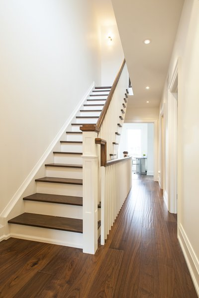 Modern home with dark hardwood floor, staircase, wood tread, and wood railing. Bickford Park - Second Floor Stairs Photo 20 of Bickford Park