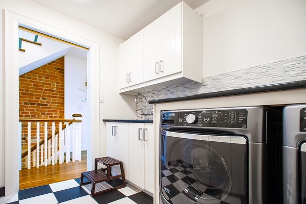 Modern home with laundry room, side-by-side, and white cabinet. Bickford Park - Laundry Room Photo 13 of Bickford Park
