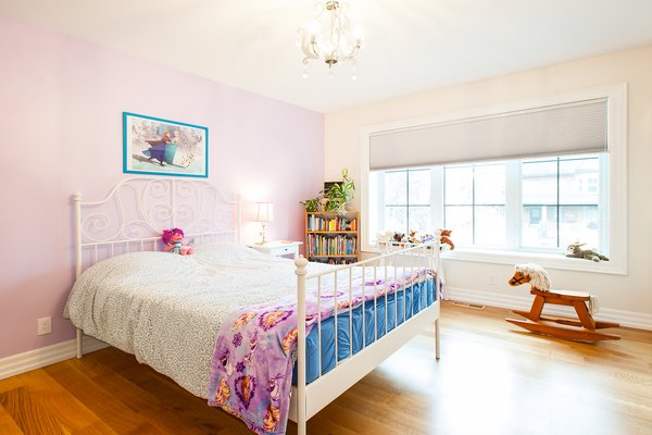 Modern home with kids room, medium hardwood floor, bed, bookcase, bedroom, and girl gender. Edwardian Renovation - Kids Bedroom Photo 9 of Edwardian Renovation