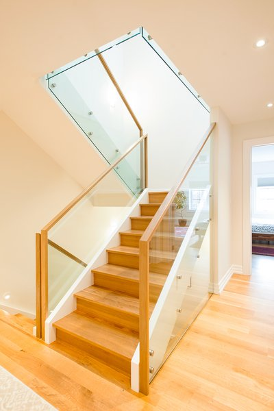 Modern home with staircase, wood tread, and glass railing. Edwardian Renovation - Stairs Photo 19 of Edwardian Renovation
