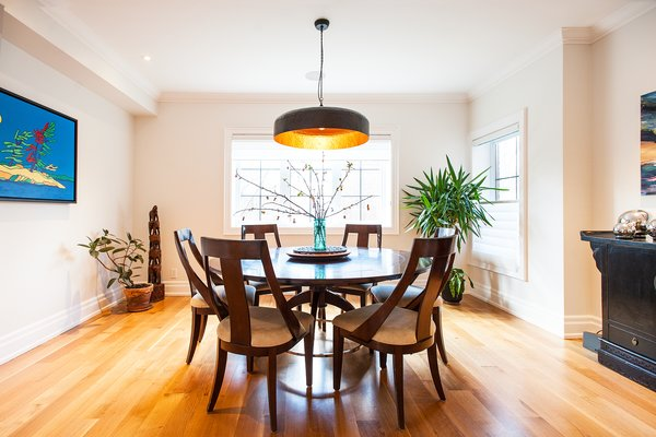 Modern home with dining room, chair, pendant lighting, table, ceiling lighting, accent lighting, and medium hardwood floor. Edwardian Renovation - Dining Room Photo 2 of Edwardian Renovation