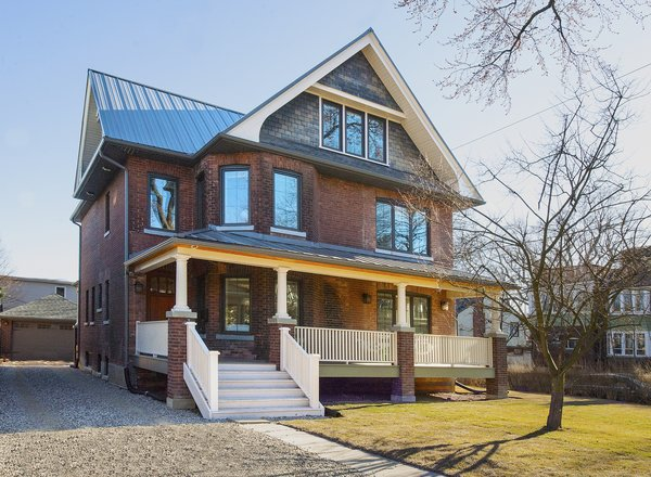Modern home with outdoor, front yard, vertical fence, wood patio, porch, deck, large patio, porch, deck, wood fence, grass, and trees. Edwardian Renovation - Exterior Photo 4 of Edwardian Renovation