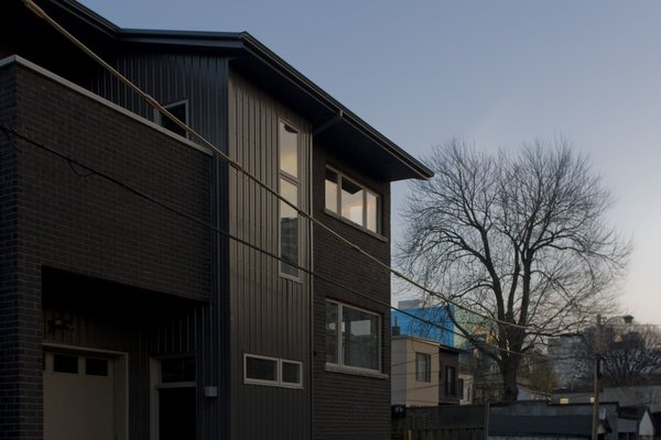 Modern home with outdoor, hardscapes, and trees. Laneway Loft - Exterior Photo 3 of Laneway Loft