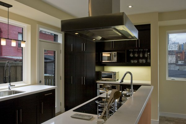 Modern home with kitchen, ceiling lighting, range hood, cooktops, microwave, and undermount sink. Laneway Loft - Kitchen Photo 10 of Laneway Loft