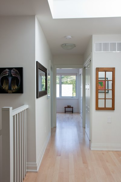Modern home with light hardwood floor, staircase, and wood railing. Roncesvalles Accessible House - Second Floor Landing Photo 6 of Roncesvalles Accessible House