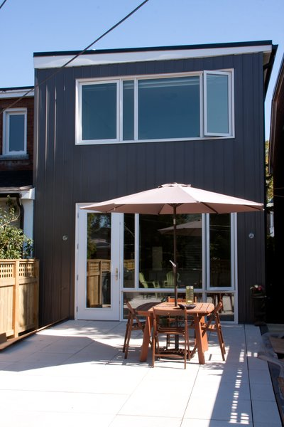 Modern home with outdoor, large patio, porch, deck, and vertical fence. Roncesvalles Accessible House - Rooftop Deck Photo 8 of Roncesvalles Accessible House