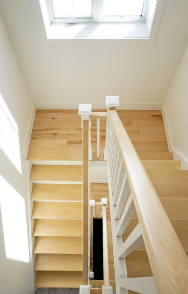 Modern home with staircase, wood railing, and wood tread. Highpoint House - Stairs Photo 8 of Highpoint House
