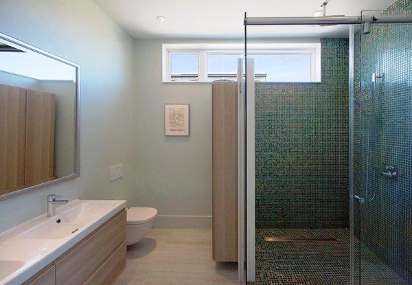 Modern home with bath room, enclosed shower, ceiling lighting, and one piece toilet. Elgin Loft - Master Bathroom Photo 11 of Elgin Loft