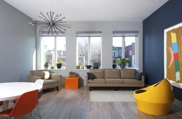 Modern home with table, chair, pendant lighting, accent lighting, living room, light hardwood floor, sofa, and recliner. Elgin Loft - Great Room Photo 8 of Elgin Loft