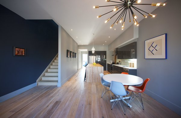 Modern home with chair, pendant lighting, table, ceiling lighting, accent lighting, light hardwood floor, and dining room. Elgin Loft - Great Room Photo 6 of Elgin Loft