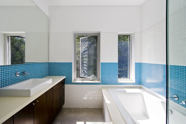 Modern home with bath room and alcove tub. Gananoque Lake Road House - Bathroom Photo 4 of Gananoque Lake Road House