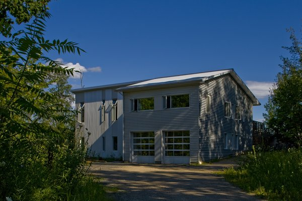 Modern home with outdoor, trees, and flowers. Gananoque Lake Road House - Exterior Photo 7 of Gananoque Lake Road House