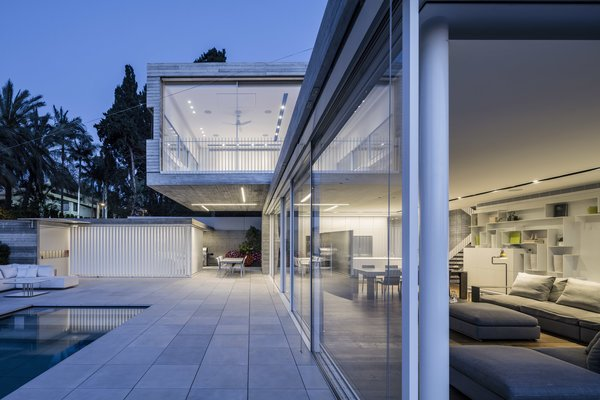 The floating mass at the top provides shading to the parts below and thus creates an outdoor space that feels like an integral part of the interior.  Photo 9 of The Dual House modern home